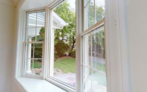 Large window looking into backyard.